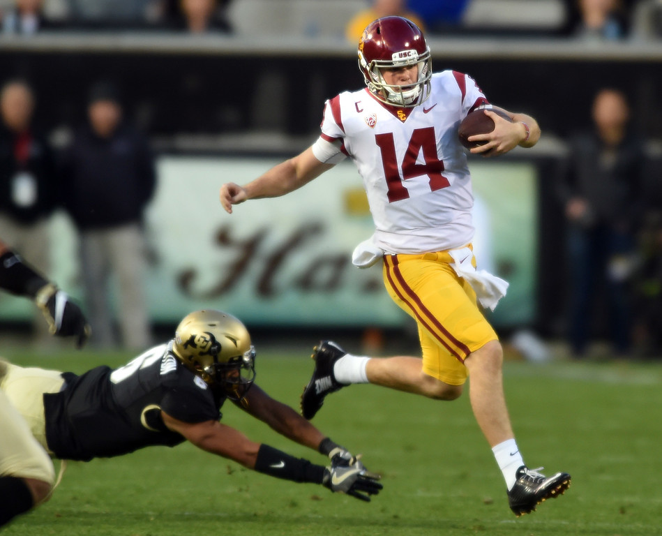 . Sam Darnold, of USC jumps out of a tackle during the November 11th, 2017 game in Boulder.  Cliff Grassmick / Staff Photographer/ November 11, 2017, 2017