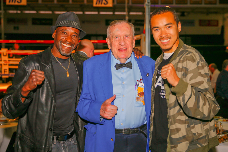 "9/30/16: Friday Night Fights at Sobrato Center in San Francisco, CA.  Marty Sammon, a local boxing referee and judge who played a referee in the movie, ""Million Dollar Baby,"", poses for a shot with a USF student and his father (Pearci Bastiany).  Image by Chris M. Leung for USF Dons Athletics"