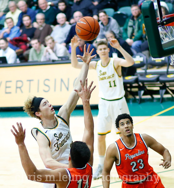 2/2/17: USF MBB vs Pepperdine at War Memorial Gymnasium in San Francisco, CA. Dons win 77-56. San Francisco Dons forward Chase Foster (22) takes it to the hoop. Image by Chris M. Leung