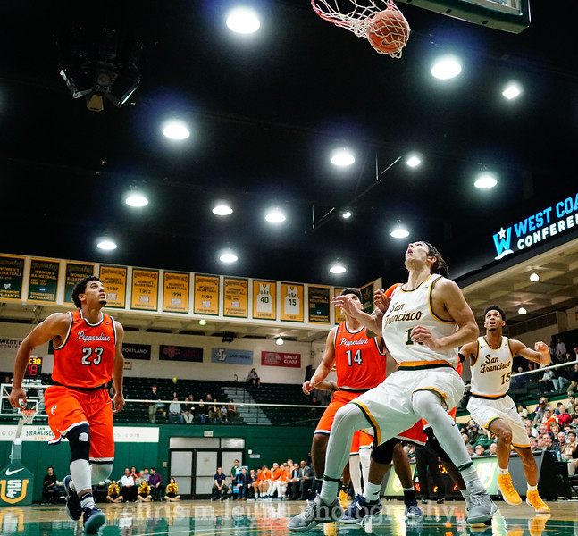 2/2/17: USF MBB vs Pepperdine at War Memorial Gymnasium in San Francisco, CA. Dons win 77-56. San Francisco Dons forward Matt McCarthy (10), San Francisco Dons forward Nate Renfro (15). Image by Chris M. Leung