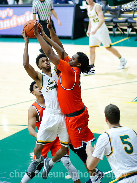 2/2/17: USF MBB vs Pepperdine at War Memorial Gymnasium in San Francisco, CA. Dons win 77-56. San Francisco Dons guard Ronnie Boyce (3) goes up for 2. Image by Chris M. Leung