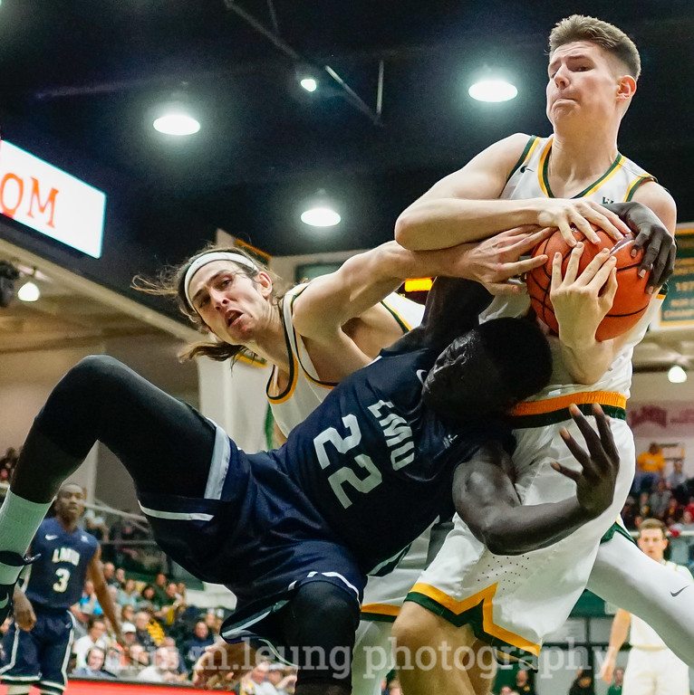2/4/17: USF MBB vs LMU at the War Memorial Gymnasium in San Francisco, CA. Dons win 74-64.. San Francisco Dons forward Matt McCarthy (10), San Francisco Dons forward Remu Raitanen (11). Image by Chris M. Leung for USF Dons Athletics