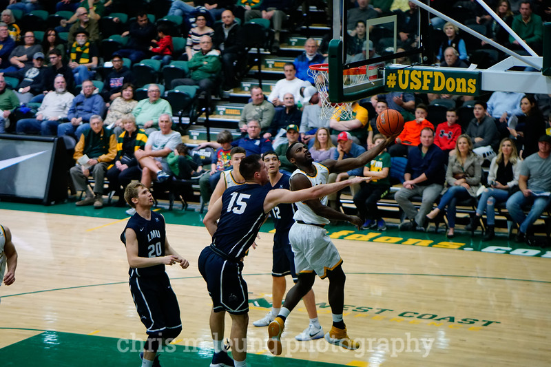 2/4/17: USF MBB vs LMU at the War Memorial Gymnasium in San Francisco, CA. Dons win 74-64. San Francisco Dons guard Charles Minlend (14). Image by Chris M. Leung for USF Dons Athletics