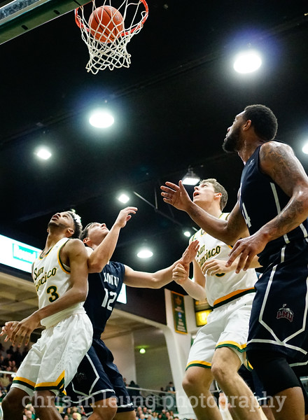 2/4/17: USF MBB vs LMU at the War Memorial Gymnasium in San Francisco, CA. Dons win 74-64.. San Francisco Dons guard Ronnie Boyce (3), San Francisco Dons center Jimbo Lull (5). Image by Chris M. Leung for USF Dons Athletics