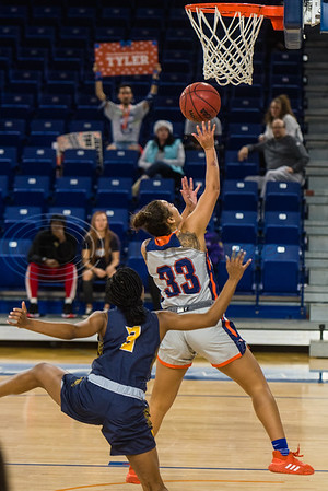 University of Texas at Tyler's Madison Davis (23) attempts a shot in front of A&M-Commerce's Chania Wright (3) during game action Saturday, Dec. 14, 2019, at the Louise Herrington Patriot Center in Tyler. (Cara Campbell/Tyler Morning Telegraph)