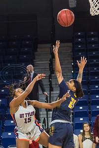University of Texas at Tyler's Lauren Riles (15) attempts a shot against A&M-Commerce's Juliana Louis (21) during game action Saturday, Dec. 14, 2019, at the Louise Herrington Patriot Center in Tyler. (Cara Campbell/Tyler Morning Telegraph)