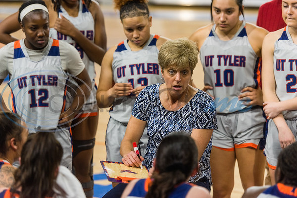 University of Texas at Tyler's Head Coach Jeanette Mosher huddles with her team in a timeout during game action against A&M-Commerce Saturday, Dec. 14, 2019, at the Louise Herrington Patriot Center in Tyler. (Cara Campbell/Tyler Morning Telegraph)