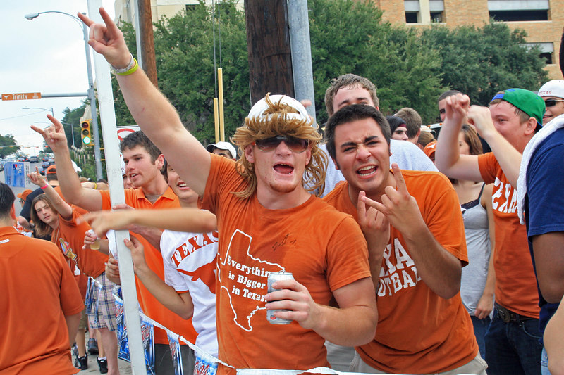 these guys were SCREAMING at passing cars, hissing at OU colors and cheering for UT colors in the cars