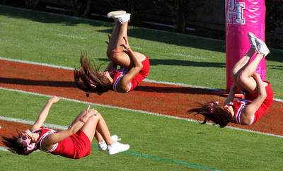 Cheerleaders doing celebratory backflips