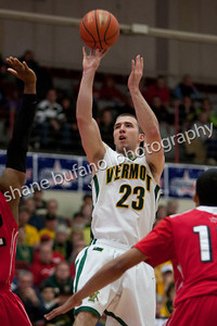 Brian Voelkel of Vermont shoots over a pair of Hartford defenders, during the America East Conference semifinal at Chase Family Arena in Hartford, CT on Sunday March 4, 2012.