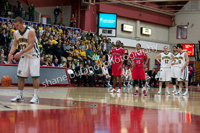 Members of Vermont and Hartford watch Brian Voelkel shoot a technical free throw in a chippy game, during the America East Conference semifinal at Chase Family Arena in Hartford, CT on Sunday March 4, 2012.