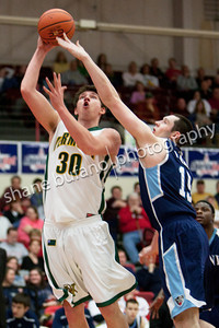 Pat Bergmann of Vermont (left) attempts a lay up over Alasdair Fraser of Maine, during the Catamounts 50-40 win in an America East Conference Quarterfinal against Maine on March 3, 2012 at Chase Family Arena in Hartford, CT.