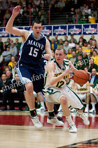 Sandro Carissimo (right) drives the baseline past Alasdair Fraser of Maine, during the Catamounts 50-40 win in an America East Conference Quarterfinal against Maine on March 3, 2012 at Chase Family Arena in Hartford, CT.