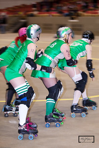 Madison Mad Rollin' Dolls Roller Derby  Quad Squad vs. Unholy Rollers  © Copyright m2 Photography - Michael J. Mikkelson 2010. All Rights Reserved. Images can not be used without permission.