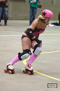 Vaudeville Vixens vs. North Star roller Girls at the Coliseum  Madison Mad Rollin' Dolls Roller Derby  © Copyright m2 Photography - Michael J. Mikkelson 2010. All Rights Reserved. Images can not be used without permission.