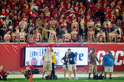 The UH Naked People cheer from the east end of TDECU...