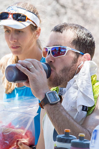 Chris Price hydrates before continuing on.
