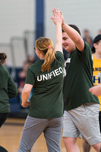 Mary Chartier and Eddie Holmes high five after a basket for the Abington Unified Basketball team against Hanover on 2/13/18 at Hanover High School [Courtesy Photo/Bill Marquardt]