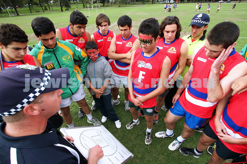 25-3-12. Unity Cup 2012. MUJU pre match address by coach Scott Sutton. Photo: Peter Haskin