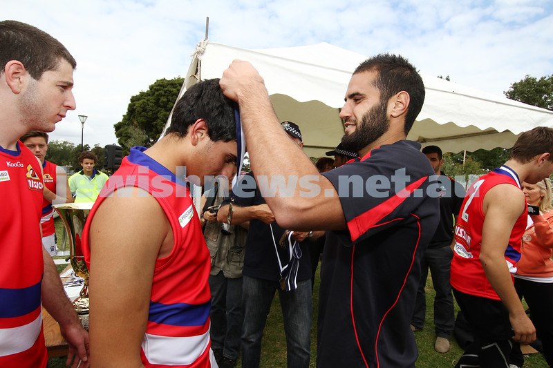25-3-12. Unity Cup 2012. MUJU Celebrating their  Grand Final victoey over the Southern Dragons. Photo: Peter Haskin