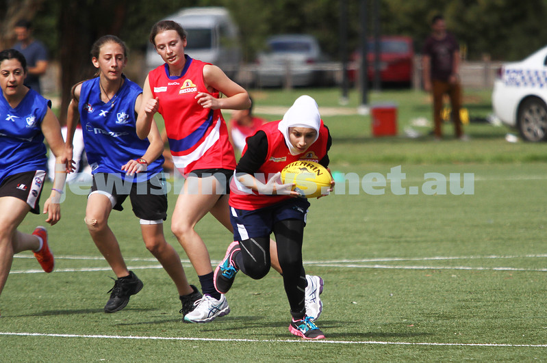 24-3-13. Unity Cup. MUJU womens team in action. Playing in the red jumpers. Photo: Peter Haskin
