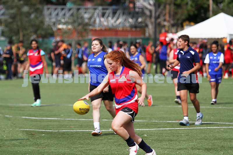 24-3-13. Unity Cup. MUJU womens team in action. Playing in the red jumpers. Chelsea Fisher. Photo: Peter Haskin