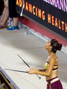 A Texas State twirler warms up.