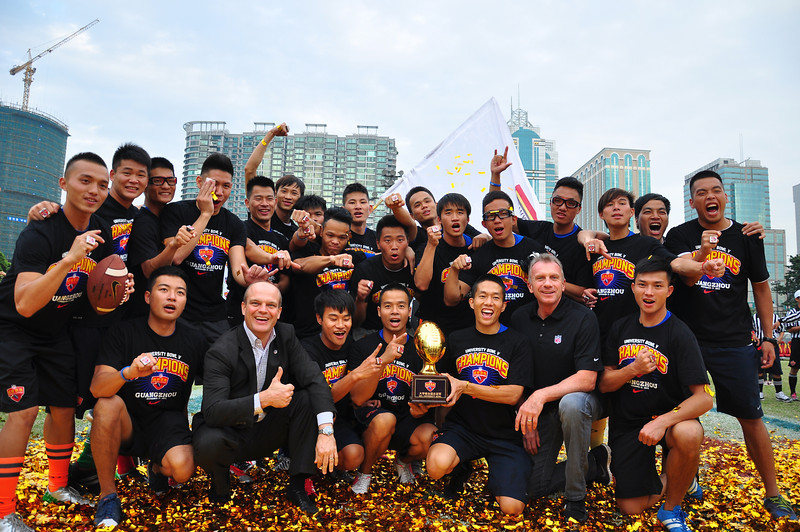 University Bowl V - Day 2 - University Bowl V championship team, Guangzhou University of Chinese Medicine with championship trophy, Richard Young (NFL China Managing Director) and NFL legend, Joe Montana