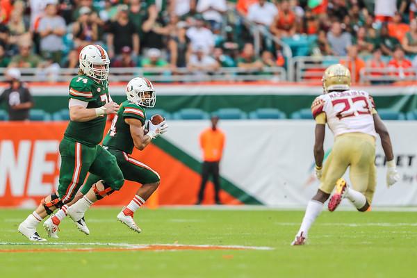 Miami Hurricanes offensive lineman Tyler Gauthier (74) looks to block Florida State Seminoles defensive back Hamsah Nasirildeen.