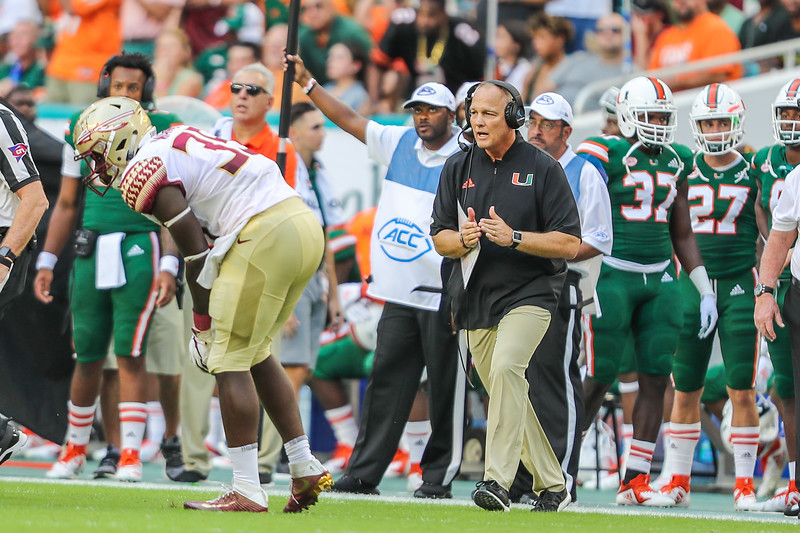 Mark Richt call a time out during a Miami Hurricanes Florida State Seminoles game.