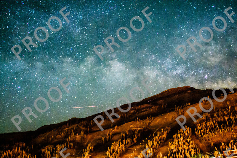 The Milky Way rises above Brian Head Peak. I believe the streaks are, from the bottom, a plane, satellite, and meteor.