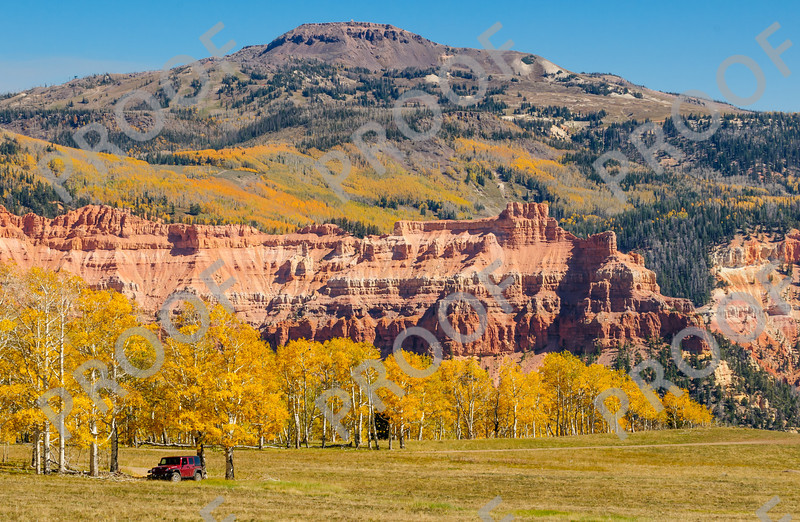 Brian Head Peak rises above spectacular fall colors and the red rock formations of Ashdown Gorge wilderness area.