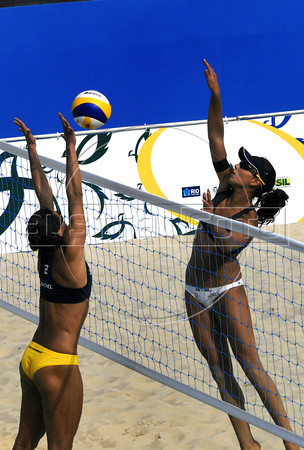 Brazil's Rachel Nunes, left, try to block an attack by the Italia's Greta Cicolari, right during a match as part of the 5th. World Military Games at Copacabana beach, Rio de Janeiro, Brazil, July 18, 2011. Italia won 2-0. Competitors from 112 countries will participate during the nine days of competitions. (Austral Foto/Renzo Gostoli)