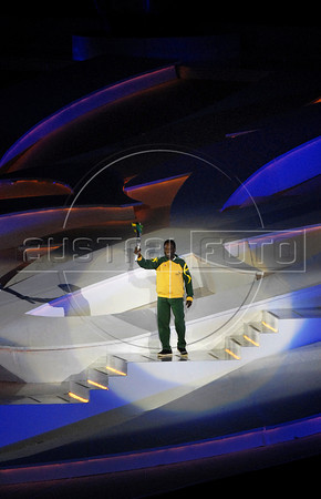 Brazilian former soccer player Edson Arantes do Nascimento, Pele holds the Olympic Flame in the inauguration ceremony of the 5th. World Military Games at Joao Havelange stadium, Rio de Janeiro, Brazil, July 16, 2011. Competitors from 112 countries will participate during the nine days of competitions. (Austral Foto/Renzo Gostoli)
