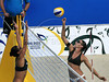 Brazil's Rachel Nunes, left, try to block an attack by the Italia's Marta Menegatti, right during a match as part of the 5th. World Military Games at Copacabana beach, Rio de Janeiro, Brazil, July 18, 2011. Italia won 2-0. Competitors from 112 countries will participate during the nine days of competitions. (Austral Foto/Renzo Gostoli)