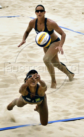 Brazil's Camila Fonseca, left, dives for the ball during a women final phase match against US team as part of the 5th. World Military Games at Copacabana beach, Rio de Janeiro, Brazil, July 22, 2011. Brazil won 2-0. Competitors from 112 countries will participate during the nine days of competitions. (Austral Foto/Renzo Gostoli)