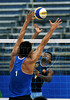 China's Zhou Shun, left, try to block an attack by the Sri Lanka's Rathnapala, right during a final phase match as part of the 5th. World Military Games at Copacabana beach, Rio de Janeiro, Brazil, July 22, 2011. China won 2-0. Competitors from 112 countries will participate during the nine days of competitions. (Austral Foto/Renzo Gostoli)