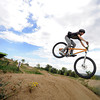 Charles Mandel readies his landing after he flies off one of the bigger jumps  on Wednesday afternoon at the Valmont Bike Park.<br /> Photo by Paul Aiken / The Camera / August 24 2011