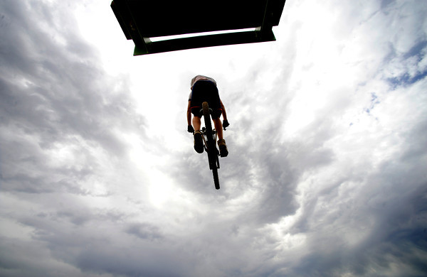 Matt Angst soars off a jump on Wednesday afternoon at the Valmont Bike Park.<br /> Photo by Paul Aiken / The Camera / August 24 2011