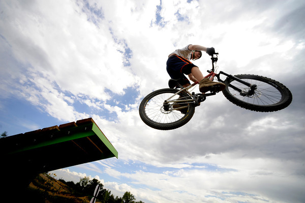 Matt Angst leaps off one of the bigger jumps  on Wednesday afternoon at the Valmont Bike Park.<br /> Photo by Paul Aiken / The Camera / August 24 2011