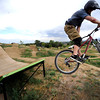 Andrew Dean flies off one of the bigger jumps  on Wednesday afternoon at the Valmont Bike Park.<br /> Photo by Paul Aiken / The Camera / August 24 2011
