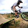 Tyler McBride tackles one of the biggest jumps  on Wednesday afternoon at the Valmont Bike Park.<br /> Photo by Paul Aiken / The Camera / August 24 2011