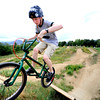 Parker Brown rides through the terrain on Wednesday afternoon at the Valmont Bike Park.<br /> Photo by Paul Aiken / The Camera / August 24 2011
