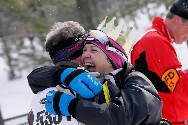 Record-Eagle/Jan-Michael Stump<br /> Women's 27k winner Amy Kostrzwa (5227) of Northville celebrates with Ken Roth (5331) Northvilleat the finish line of Saturday's 2012 VASA Saturday at Timber Ridge.