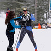 Record-Eagle/Jan-Michael Stump<br /> Tomas Linden (5230) of Stevensville, the men's 27k freestyle winner, receives a crown and bottle of sparkling cherry juice from volunteer Irma Brownley at the finish of the 2012 VASA Saturday at Timber Ridge.