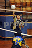 #10 Ben Abelido, WHHS, setter, hits one over to #18 Kevin Roncancio, Lawrence HS. April 6th, 2009 at LMS. Photo by Kathy Leistner