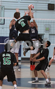 Granada's #6 Sean Greene gets way up to put away a kill shot over #30 Alex Frapech