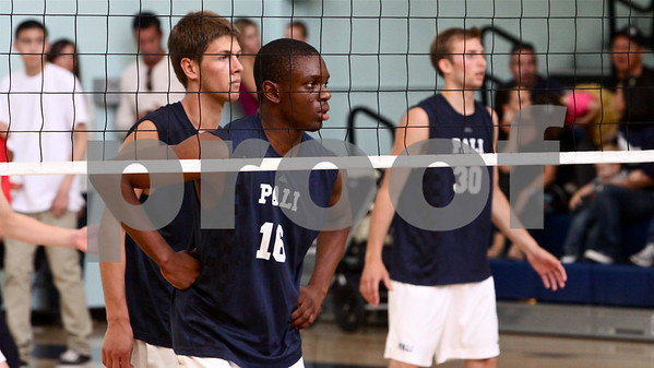 Palisades players opposite hitter Amaechi Izuchukwu #16, setter Jack Scharf and outside hitter Alex Frapech #30 wait on a Granada Hills serve
