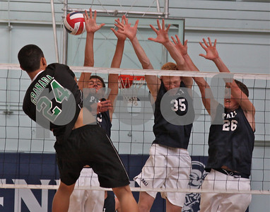 Granada's outside hitter Jino Labao spikes a winner past Palisades Jack Scharf, Conor Nasch, and Denton Van Duzer