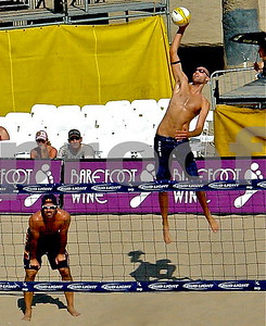 The Thin Beast and The World's Best Player, Two Time Olympian and Olympic Champion Phil Dalhausser serves as his Olympic teammate Todd Rogers waits at the net, Manhattan Beach Open.